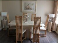 beautiful Italian stone dinning table and chairs.