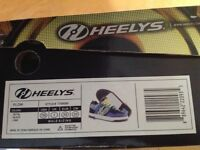 Heelys size 5(38) silver and size1 (33) blue/black/yellow. New last Christmas and hardly worn.