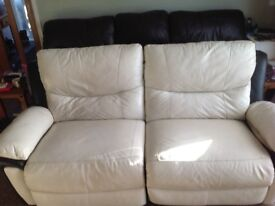 Large 2 seater Cream and black electric reclining Sofa.