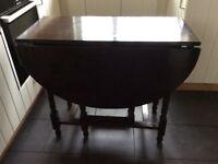 Vintage Drop leaf table. Good solid table . Gateleg. Lovely graining. Some marks on top
