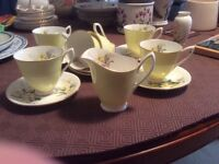 Royal Albert bone china coffee set circa 1960. Six cups and saucers and milk jug. Daffodil design