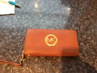 Genuine Michael kors purse .. tan leather never used