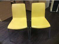 Twenty Yellow Leather Stacking Chairs