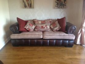Almost brand new 3 seater sofa and swivel foxy chair.