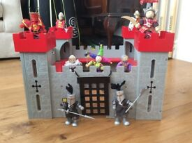 Toy castle with knight figures