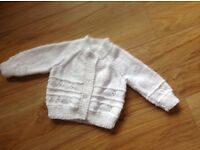 Baby's hand-knitted Cardigan.