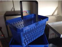 Blue shopping baskets with stand