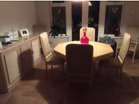 Dining table with chairs and matching sideboard
