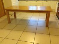 Solid oak table. Seats eight
