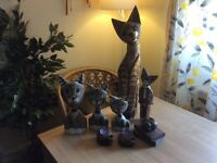 8 wooden cats