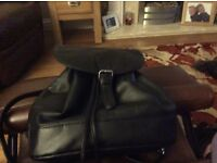 Small black leather backpack. In excellent condition. Lovely patterned lining