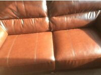 Living room sofas 3 seat and 2 seat chestnut brown still looks new no scratches on damages