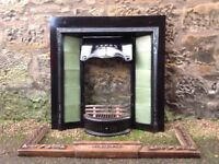 Antique Fireplace with grate and wooden fender.