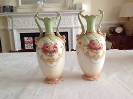 Beautiful pair of matching Edwardian vases. Green and pink on an ivory background.