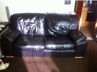 Large leather sofa with pull out bed.