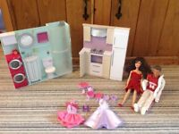Barbies, bathroom and kitchen and accessories.