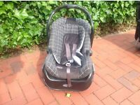 GRACO car seat with integral carry handle and base.