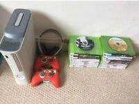 Xbox 360 console with 2 controllers, a headset and 20 games