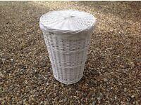 Large white wicker laundry basket