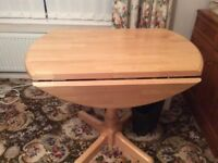 Round drop-leaf dinning room table as new