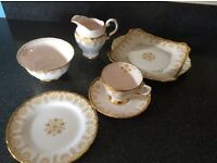 Tea service. 27 piece Fine English bone china. Cream and gold.