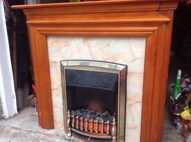 Electric Fire with real coal complete with wooden mantle surround.