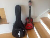 3/4 Classical Guitar, Redburst, by Gear4music complete with gig bag.