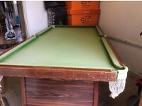 Small snooker table with accessories