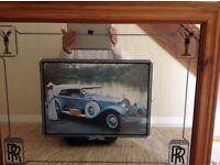 Mirror with RR Rolls Royce in centre and symbols RR in corner.