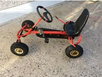 BERG KIDS RIDE ON PEDAL POWERED GO CART. BLACK AND RED. ROBUST CONSTRUCTION BY BERG