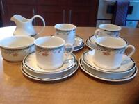Set of 4 Royal Doulton cups, saucers and plates including a sugar bowl and milk jug