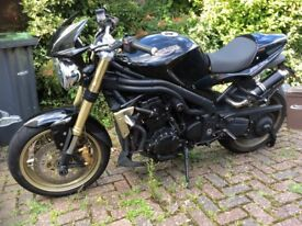 Triumph 1050 speed triple.As seen in The Hit Mans Body Gaurd.Extras