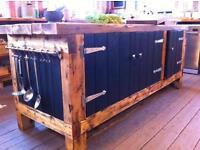 Freestanding kitchen island with storage cupboards