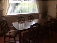 Dark wood dinning table & chairs, with matching sideboard