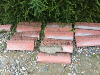 For sale terracotta rope edge tiles used some already dug up, others available. Buyer collects