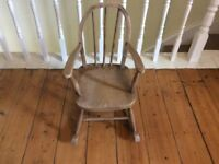Antique wooden rocking chair for a child