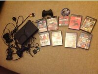 PlayStation 2 original release with 2 controllers, 2 memory cards and 9 games