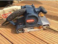 Ryobi 1310v belt sander in box with sanding frame and spare belts