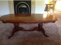 Italian style ornate coffee table with inlaid design on top