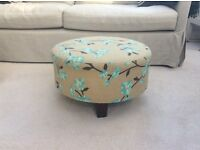 Small upholstered footstool/table