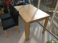 Modern table and 4 faux leather chairs