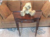 Small mahogany half round regency style table