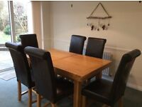 Extending Solid Oak dining table plus 6 chairs