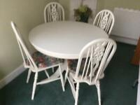 Delightful circular table and 4 chairs.