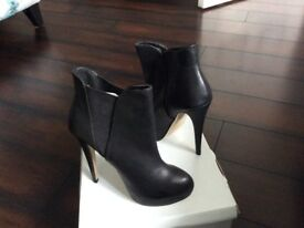 Ladies high heeled platform boots
