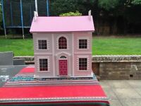 Wooden Dolls House. Pastel pink, 2 floors. A family of 6 dolls with lots of accessories.