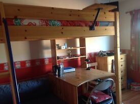 Solid pine high sleeper bed with desk, sofa and pull out bed.
