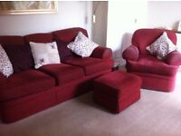 Red 3 piece suite for sale, which includes a 3 seater sofa, armchair and pouffe.