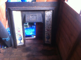 Iron fireplace with tiled inserts in good condition