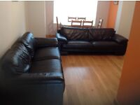Two 3 seater leather sofas.
